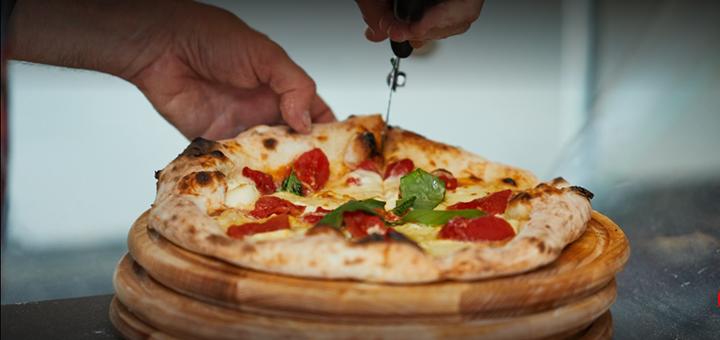 Скидка 40% на маленькие или большие пиццы в пиццерии «Buhari» на Сумском рынке