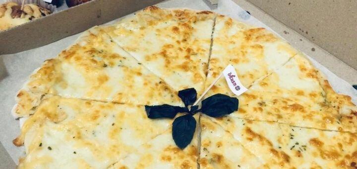 Скидка 50% на всю пиццу, чай и кофе в пиццерии «Vkusno»