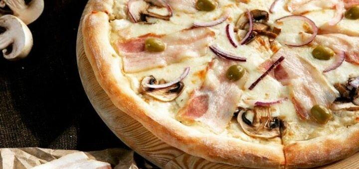 Скидка 50% на всё меню пиццы в пиццерии «Pizza Rich»