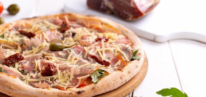 Скидка до 50% на все меню раздела WOK и пиццу от службы доставки «LeoPizza»