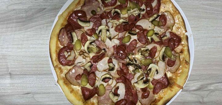 Скидка 40% на пиццу от службы доставки «Street Food Pizza»