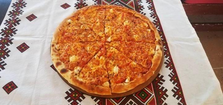 Скидка до 50% на килограммовые пицца-пироги в пиццерии «Pizza Maya»